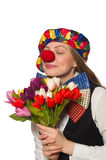 Pretty female clown with flowers isolated on white Royalty Free Stock Photography