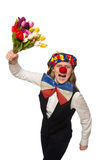 Pretty female clown with flowers isolated on white Stock Images