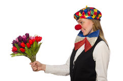 Pretty female clown with flowers isolated on white Stock Image