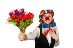 Pretty female clown with flowers Royalty Free Stock Photos