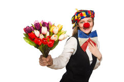Pretty female clown with flowers isolated on white Royalty Free Stock Image