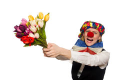 Pretty female clown with flowers isolated on white Royalty Free Stock Photo