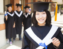 Pretty  female college graduate holding diploma Royalty Free Stock Photos