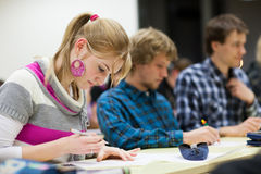 Pretty female college student  in a classroom Stock Photography