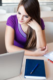 Pretty female college student in classroom Royalty Free Stock Images