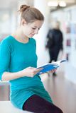 Pretty female college student in a library Stock Photography
