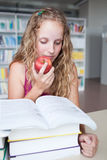 Pretty female college student in a library Stock Photo