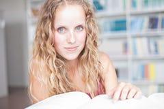 Pretty female college student in a library Stock Photo