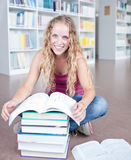 Pretty female college student in a library Stock Photos