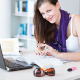 Pretty female college student in the  library Royalty Free Stock Photo