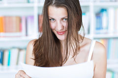 Pretty female college student in the  library Royalty Free Stock Images