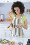 Pretty female cooking cake Royalty Free Stock Image