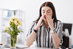 Pretty female covering her nose Royalty Free Stock Photo