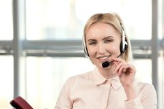 Pretty female customer support executive on customer call. royalty free stock photo