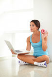 Pretty female on diet using laptop Stock Photo