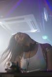 Pretty female DJ dancing Stock Photography