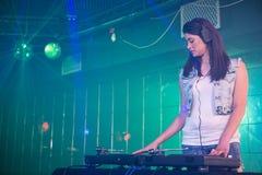 Pretty female DJ playing music Stock Photo