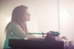 Pretty female DJ playing music Royalty Free Stock Image