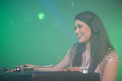 Pretty female DJ playing music Royalty Free Stock Photography
