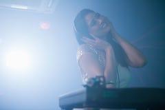 Pretty female DJ playing music Royalty Free Stock Photos