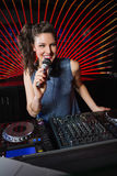 Pretty female DJ playing music Stock Photo