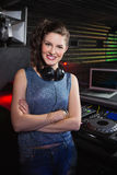 Pretty female DJ standing with arms crossed Stock Photos