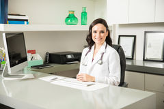 Pretty female doctor in her office Stock Image