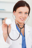 Pretty female doctor with stethoscope Stock Photo