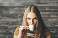 Pretty female drinking coffee Royalty Free Stock Image