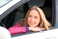 Pretty female driver. In a white car Stock Images