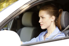 Pretty female driver. In a white car Royalty Free Stock Images