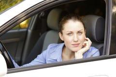 Pretty female driver. In a white car Stock Image