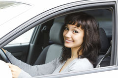 Pretty female driver. In a white car Stock Photo