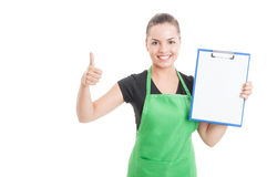 Pretty female employee with clipboard thumb up Royalty Free Stock Image