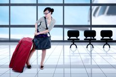 Female entrepreneur pulling suitcase at the airport Stock Photography