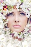 Pretty female face among the petals Royalty Free Stock Photo