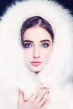 Pretty Female Face in White Fur. Young Fashion Model Royalty Free Stock Image