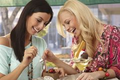 Friends sharing a cake smiling Stock Photo