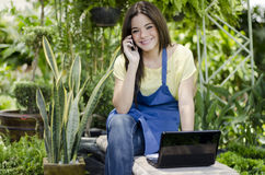 Pretty female gardener at work Stock Images