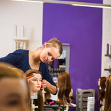 Pretty female hairdresser/haidressing apprentice Stock Image