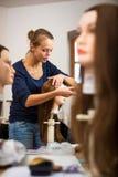 Pretty female hairdresser/haidressing apprentice/student Royalty Free Stock Photos