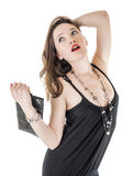 A pretty female with her purse and necklace. A pretty female dressed in a black dress with her purse and necklace isolated on white Stock Photo