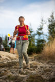 Pretty, female hiker going downhill Stock Photography