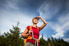 Pretty, female hiker going downhill Stock Image
