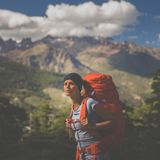 Pretty, female hiker in high mountains Stock Photos