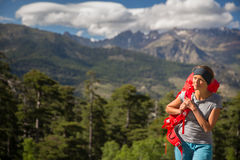 Pretty, female hiker in high mountains Stock Photo