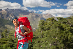 Pretty, female hiker in high mountains Royalty Free Stock Photos