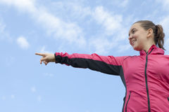 Pretty female hiker showing pointing on something Royalty Free Stock Photo