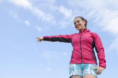 Pretty female hiker showing pointing on something Royalty Free Stock Images