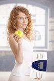 Pretty female holding apple and scale in hands Stock Photo